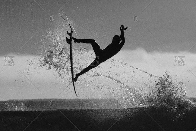 Surfer caught mid flight