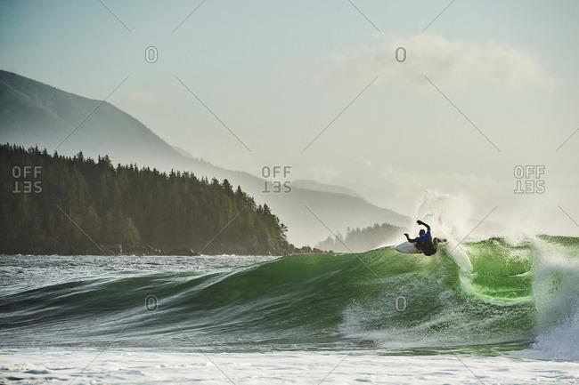Surfer turns on a frigid canadian wave