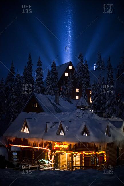 The mountain Village of Dragobrat, Ukraine lit up at night in the winter.