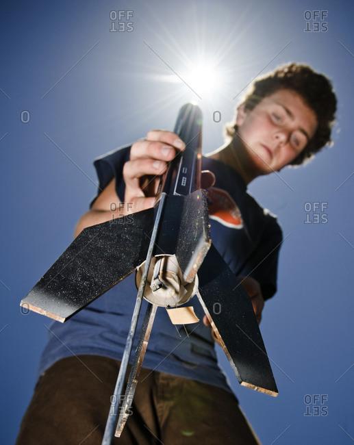 A boy prepares to launch a model rocket.