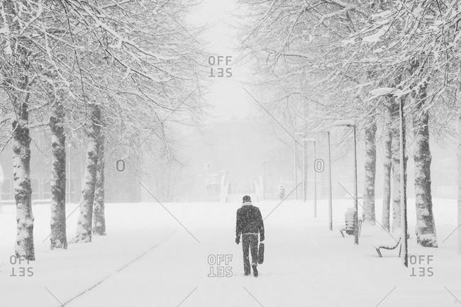A person walks through a snow storm in Amsterdam, the Netherlands