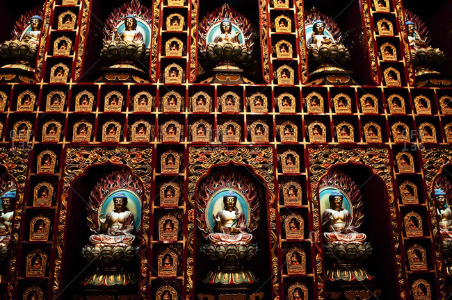 Buddha covers the walls at the Buddha Tooth Relic Temple and Museum in Singapore