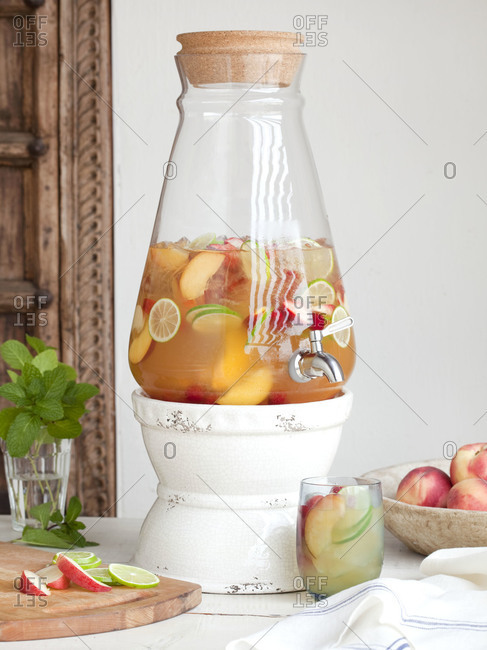 Sangria with summer fruits in a spigot jar