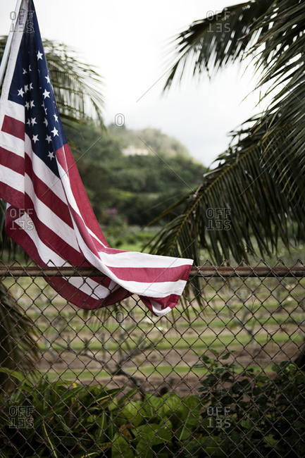 American flag by security fence