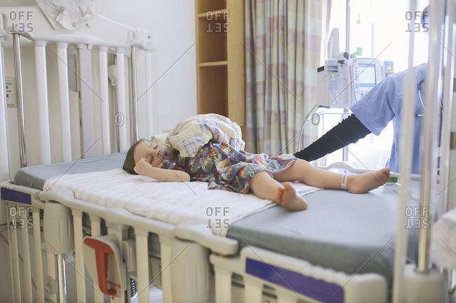 Boy sleeping on a hospital bed