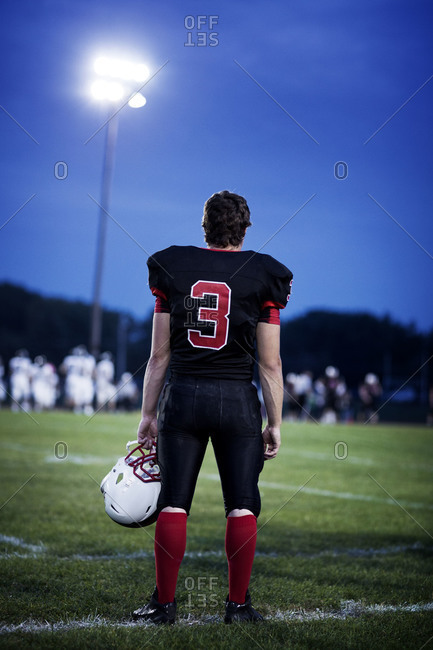 Football player standing at a field