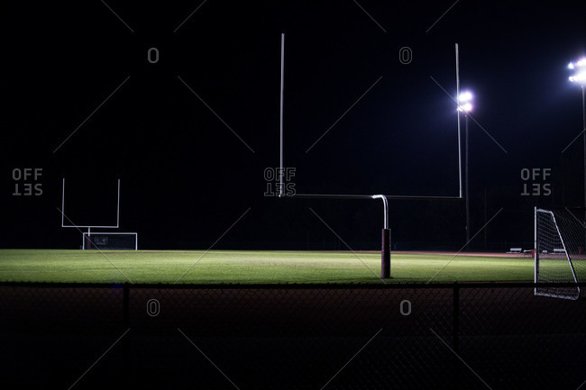 Empty football field lit up at night