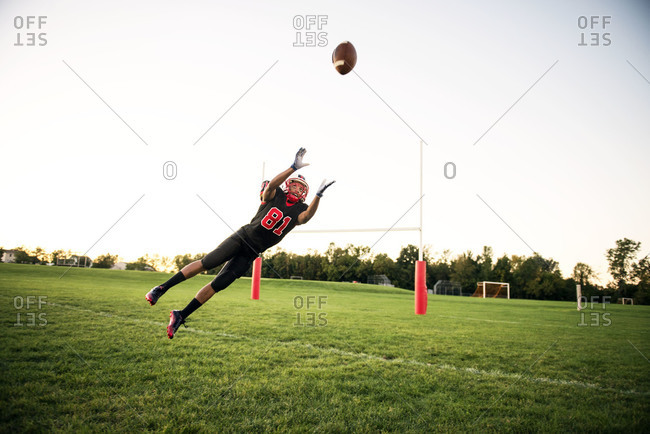 Football player catching a ball