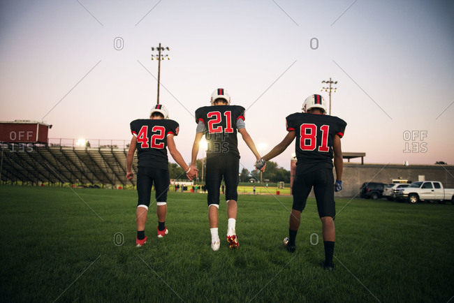 American football players walking on field