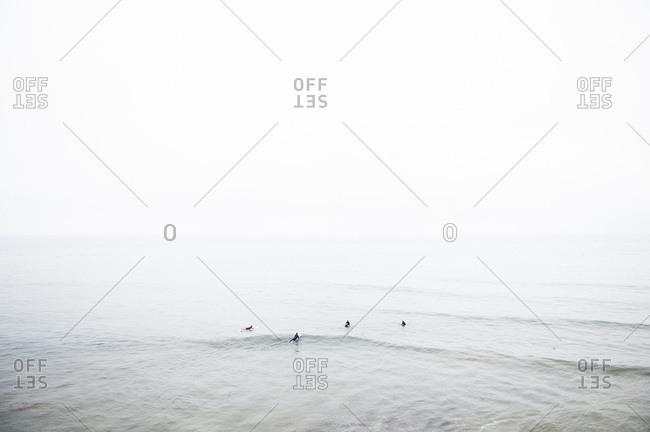 Surfers on the waves