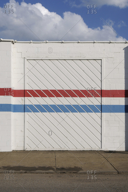 View of a white wall with red and blue stripes