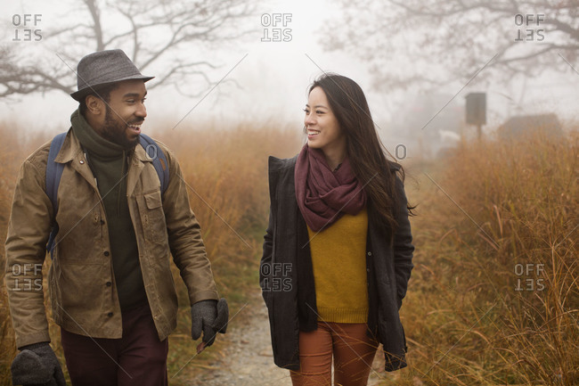 Couple taking a walk in foggy weather