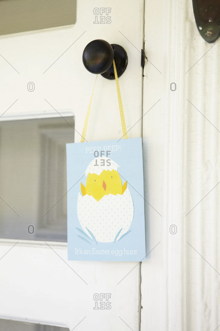 Easter egg hunt card hanging on a door handle
