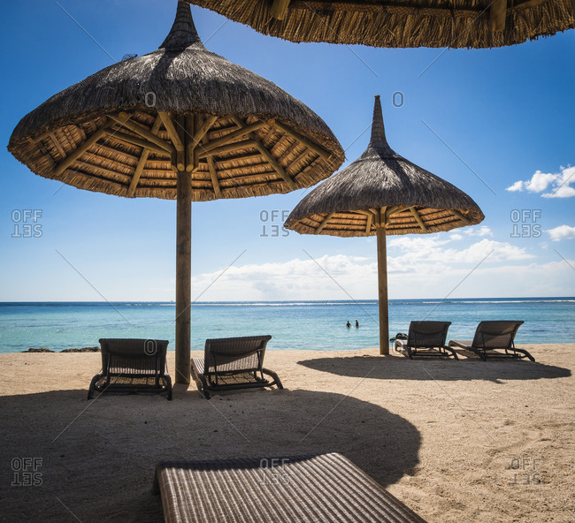 Mauritius, sunshades and beach chairs in front of the sea
