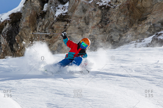 Switzerland, Grisons, Obersaxen, Boy skiing
