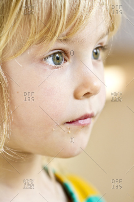 Portrait of astonished little girl, close-up