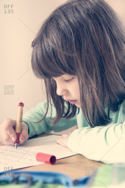 Portrait of little girl doing homework