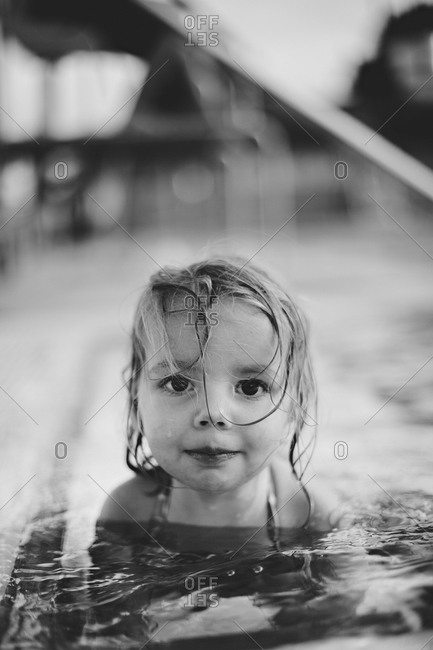 Portrait of a girl sitting in a pool