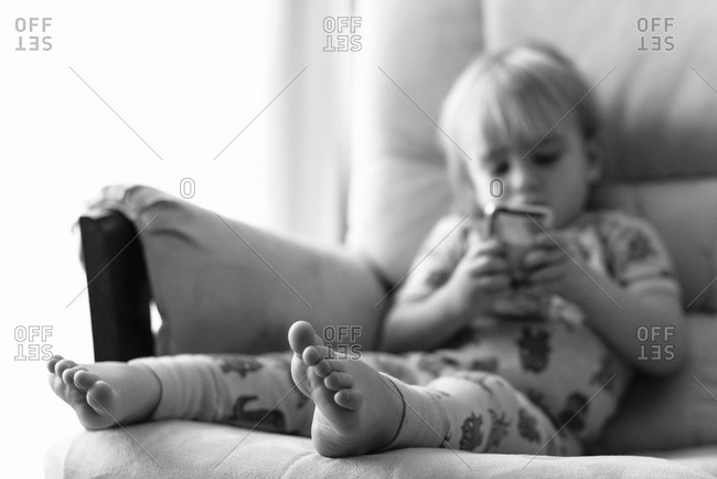 Toddler boy playing on mobile phone