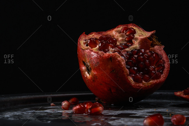 Pomegranate on pewter plate