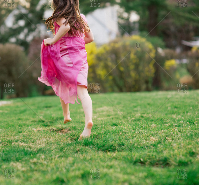 Young girl running in princess dress