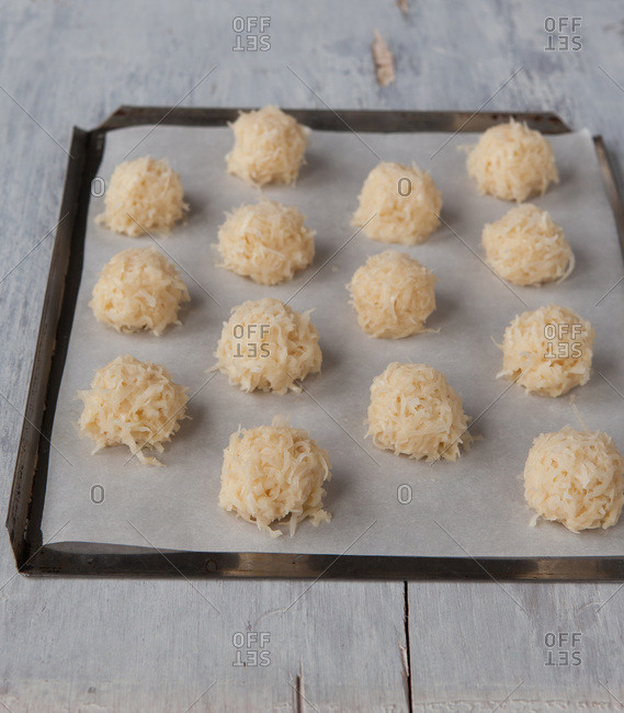 Raw coconut macaroons on a baking tray