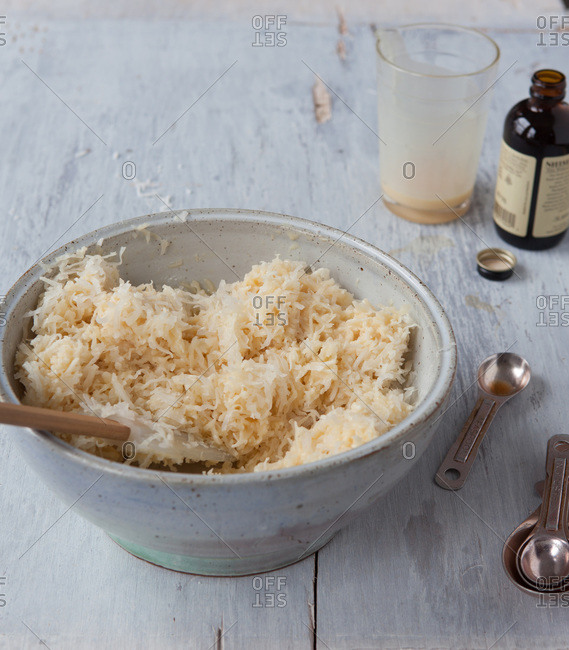 Mixing shredded coconut into the macaroon pastry