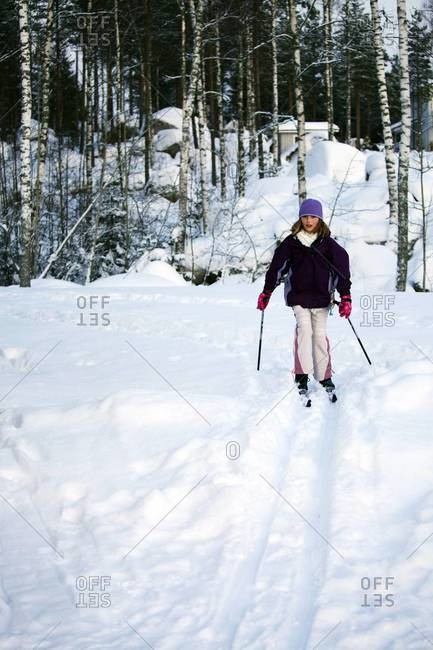 Ten year old girl cross-country skiing, Finland, Scandinavia, Europe