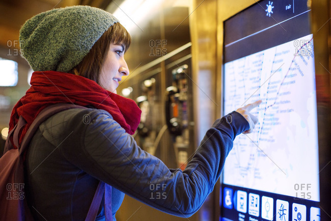 Woman pointing on a map at a railway station
