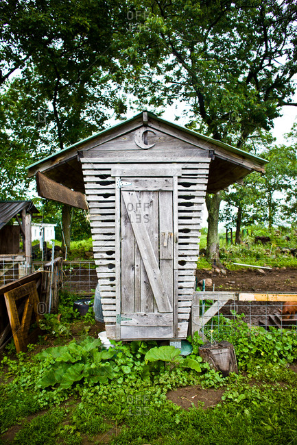 An old outhouse in a barn yard