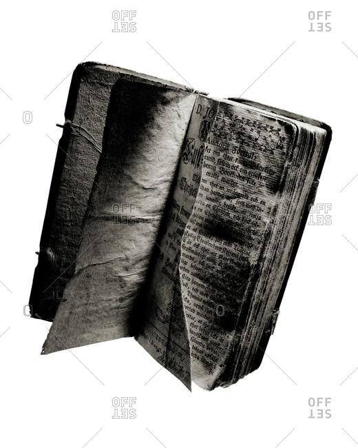 Worn and open book in black and white