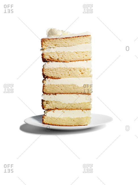 Piece of layered cake with coconut buttercream