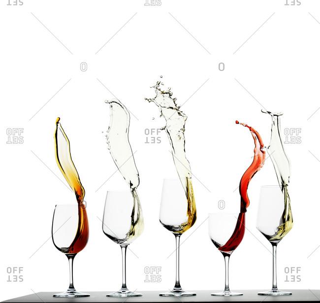 Splash of various wines in glasses
