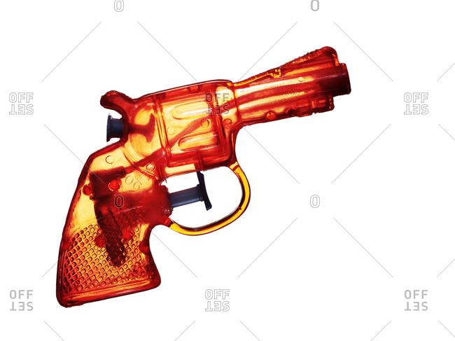 Squirt gun on white background