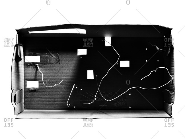 Top view of carton box with wires in black and white
