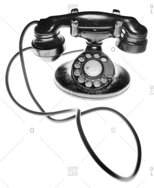 Black and white image of an antique telephone