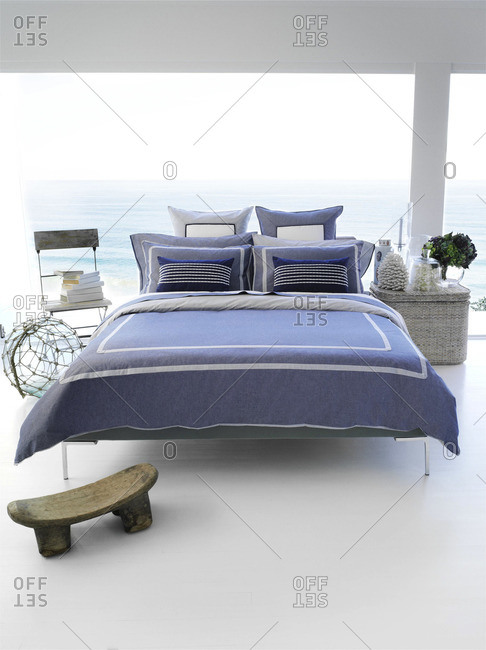 Interior of a bedroom with view over the ocean