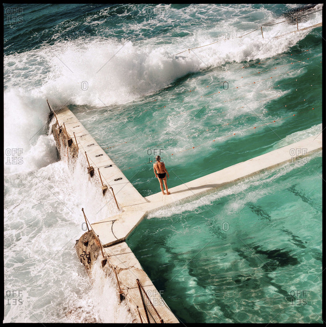 Swimming pool being crushed by the ocean