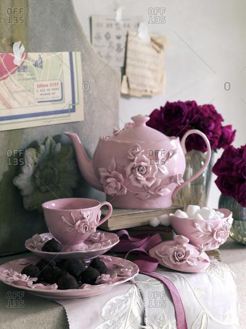Pink tea set with floral decoration