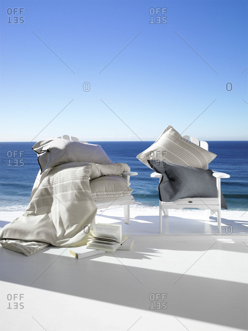 Chairs on a terrace with view over the ocean