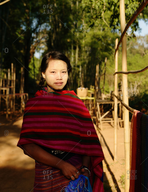 Inle Lake, Burma, Myanmar, Southeast Asia - December 17, 2013: Portrait of Burmese young girl with Thanaka on her face