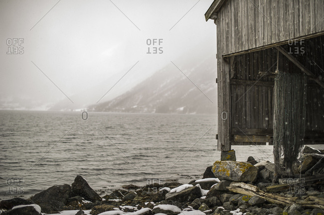 Wooden barn on coast in Norway