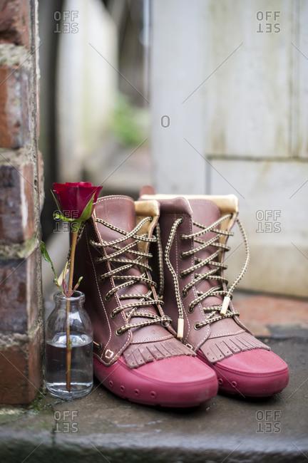 Rose in vase left on doorstep