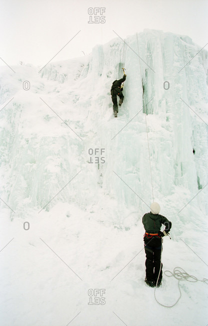 Two people ice climbing