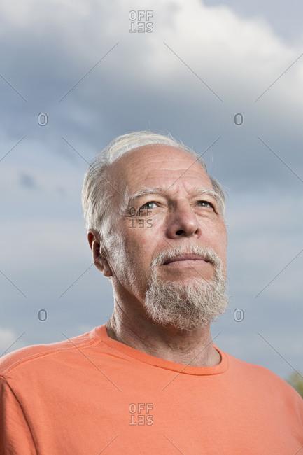 Senior man looking up, close-up