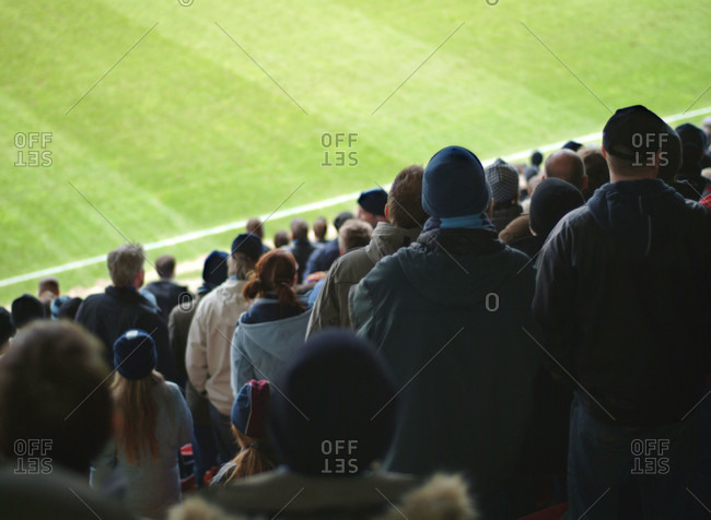 Spectators watching a soccer match from the stand