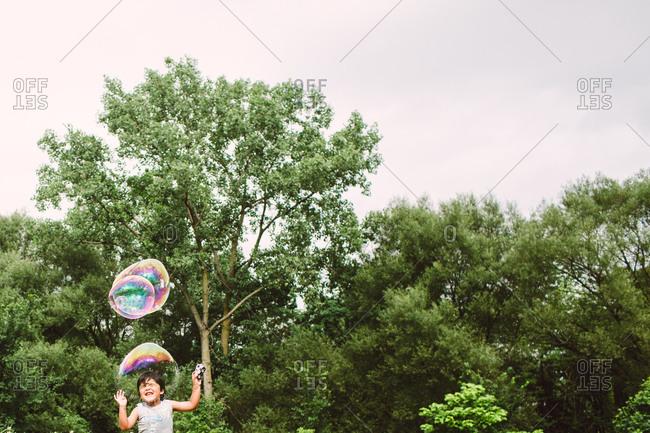 A bubble bursting over a boys head