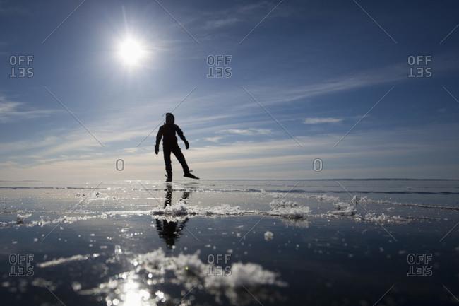 Ice skater in backlight