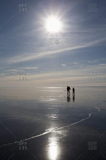 Ice skaters in backlight