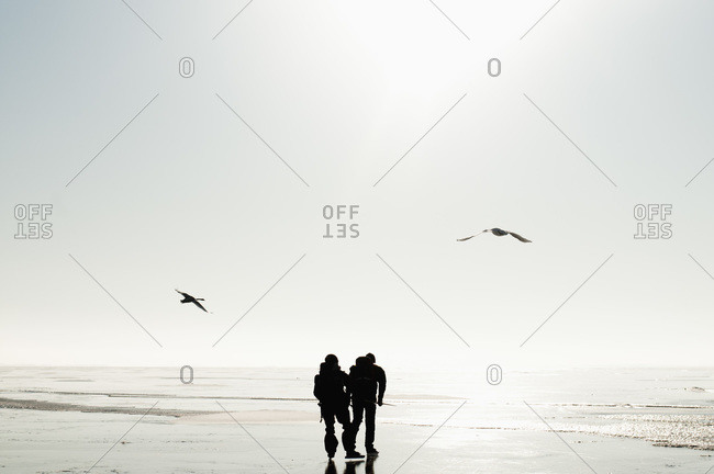 Two people and birds